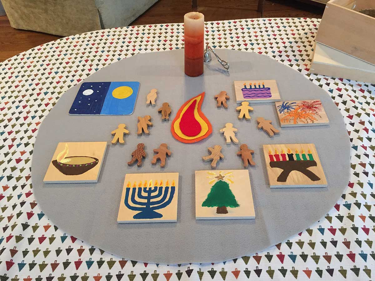 Images of Celebrations with flat wooden people figures on table